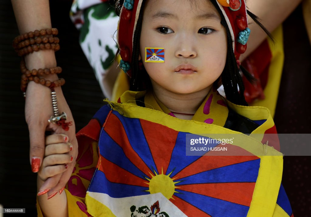 A young Tibetan exile residing in India looks on during a protest rally in New Delhi on March 10, 2013. The protest marked the 54th anniversary of the Tibetan national uprising, the 1959 rebellion against China's rule in Tibet. AFP PHOTO/ Sajjad Hussain