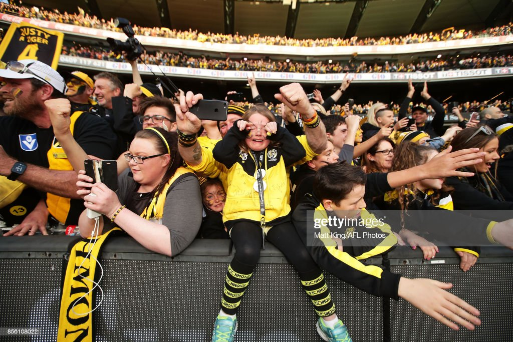 A young Tigers fan reacts and celebrates after the 2017 AFL Grand Final match between the Adelaide Crows and the Richmond Tigers at Melbourne Cricket Ground on September 30, 2017 in Melbourne, Australia.