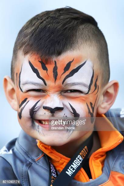 A young Tigers fan shows his colours during the round 20 NRL match between the Wests Tigers and the Parramatta Eels at ANZ Stadium on July 23 2017 in...