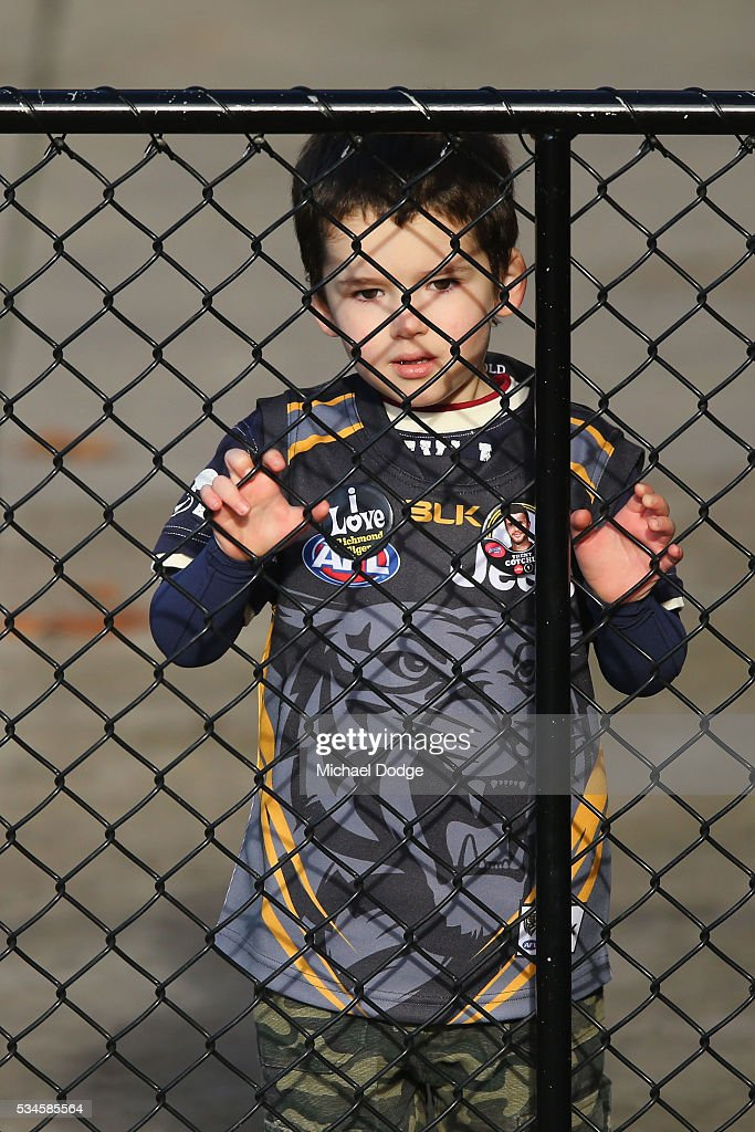 A young Tigers fan waits for players to come out during a Richmond Tigers AFL training session at ME Bank Centre on May 27, 2016 in Melbourne, Australia.