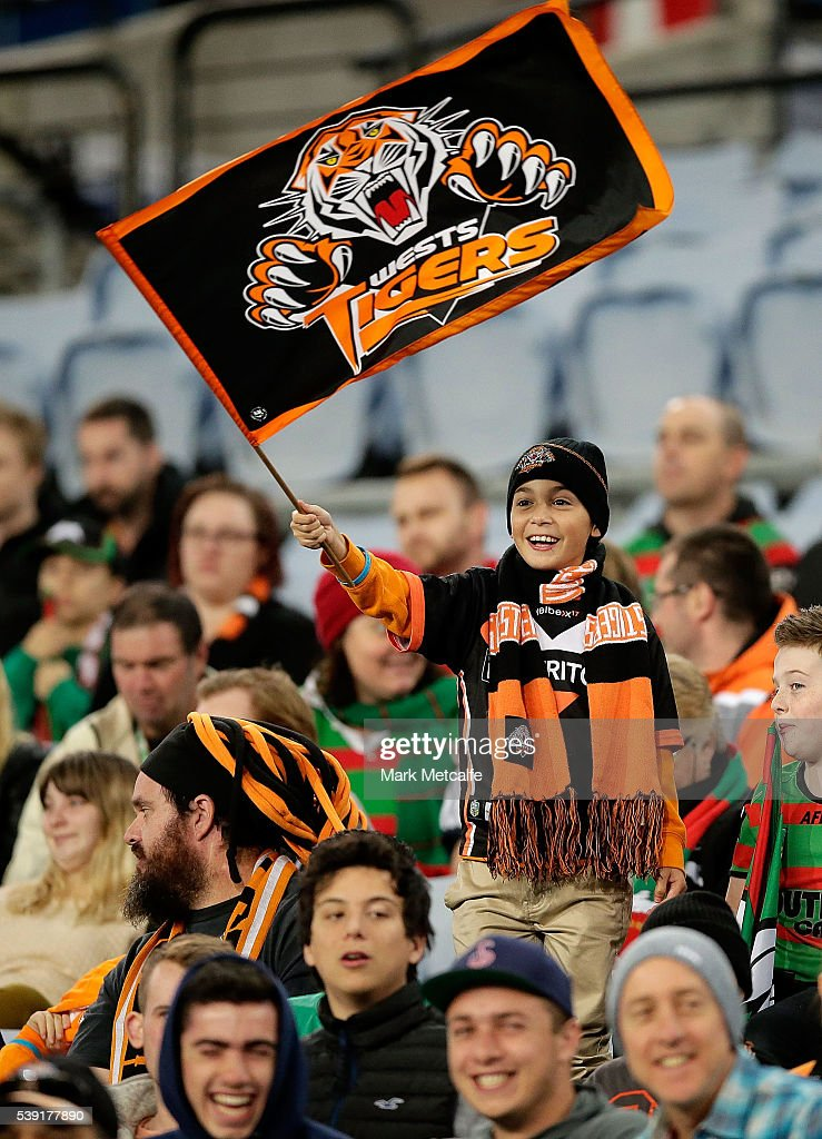 A young Tigers fan waves a flag during the round 14 NRL match between the Wests Tigers and the South Sydney Rabbitohs at ANZ Stadium on June 10, 2016 in Sydney, Australia.