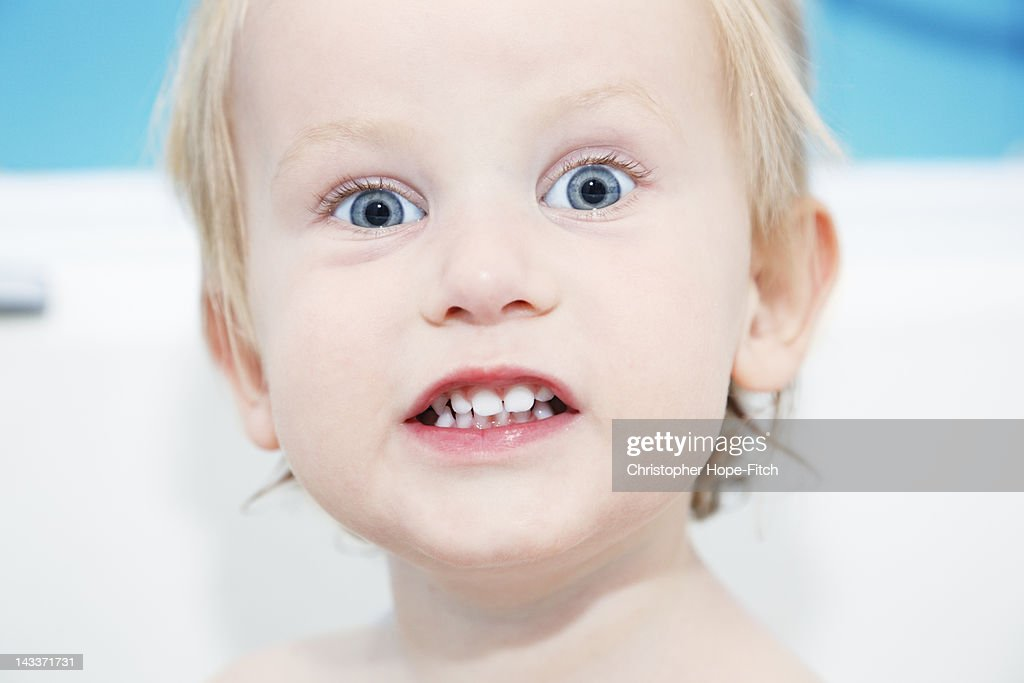 Young toddler with toothy grin : Stock Photo