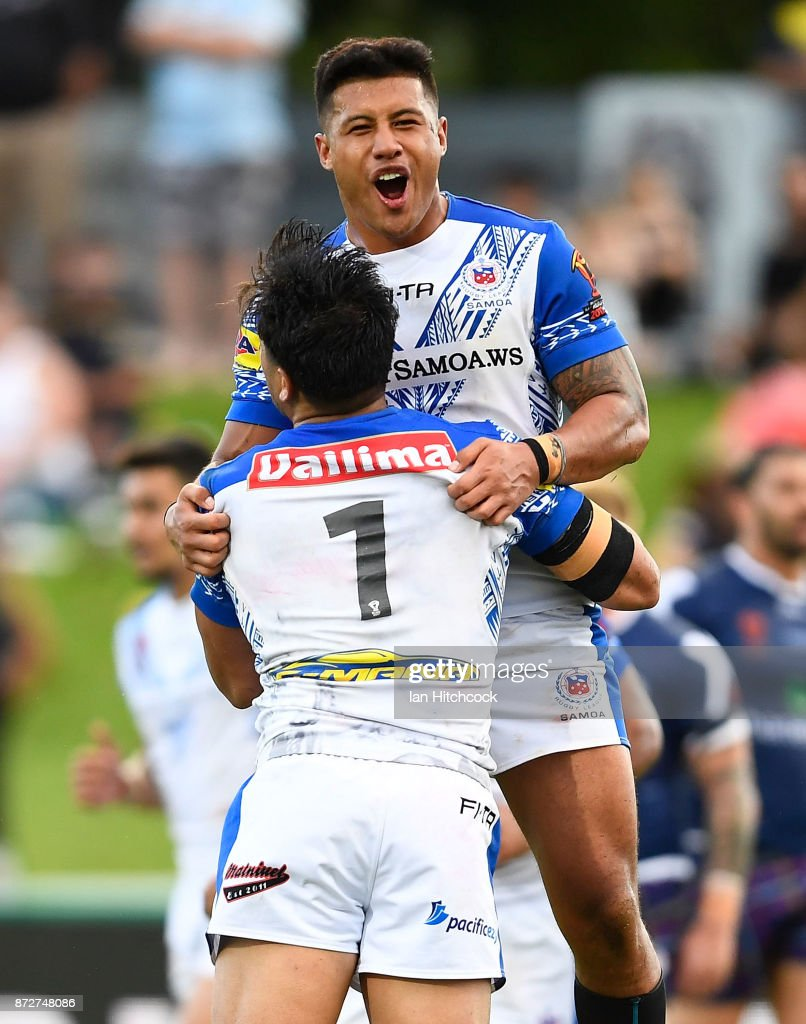 Young Tonumaipea #1 of Samoa celebrates after scoring a try with Fa'amanu Brown of Samoa during the 2017 Rugby League World Cup match between Samoa and Scotland at Barlow Park on November 11, 2017 in Cairns, Australia.