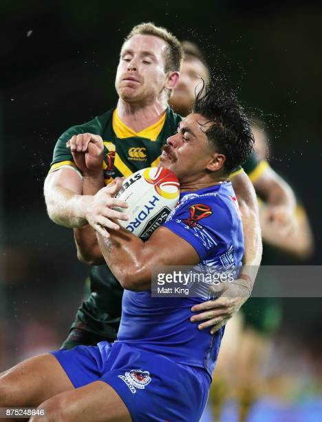 Young Tonumaipea of Samoa is tackled by Michael Morgan of Australia during the 2017 Rugby League World Cup Quarter Final match between Australia and...