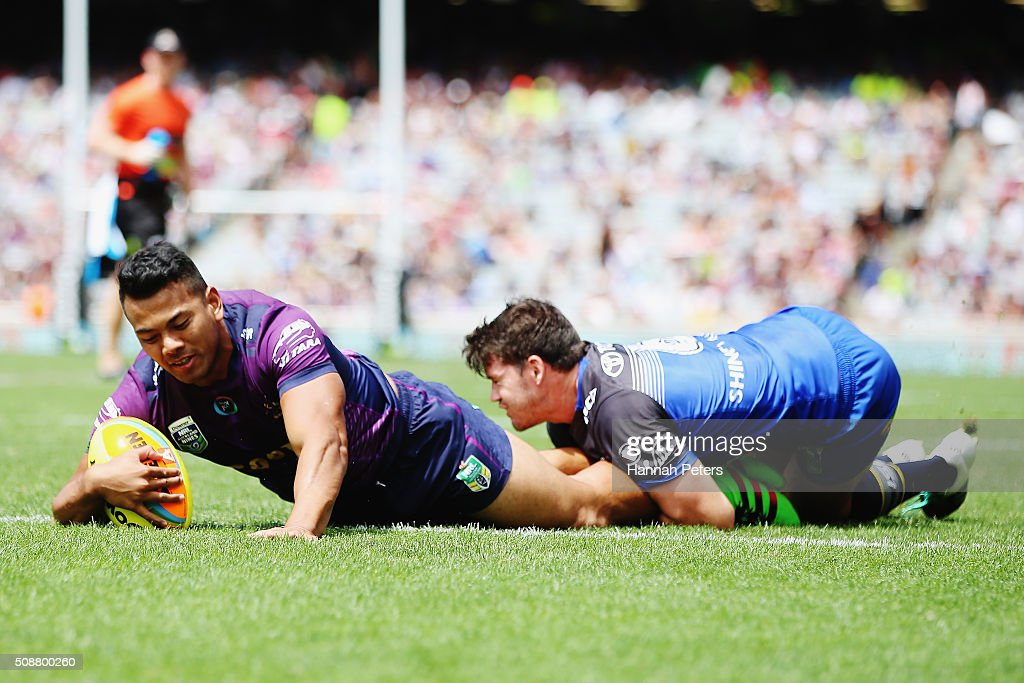 Young Tonumaipea of the Melbourne Storm dives over to score a try during the 2016 Auckland Nines quarter final match between the Melbourne Storm and the North Queensland Cowboys at Eden Park on February 7, 2016 in Auckland, New Zealand.