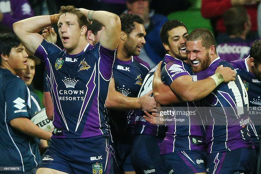 Young Tonumaipea (2nd right) of the Storm celebrates with Kenny Bromwich after scoring the match winning try during the round 6 NRL match between the Melbourne Storm and the St George Illawarra Dragons at AAMI Park on April 14, 2014 in Melbourne, Australia.
