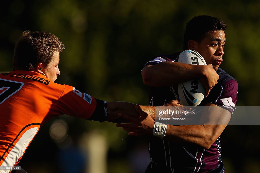 Young Tonumaipea of the Storm is tackled during the NRL trial match between the Melbourne Storm and Brisbane Easts at Gosch's Paddock on February 2, 2013 in Melbourne, Australia.