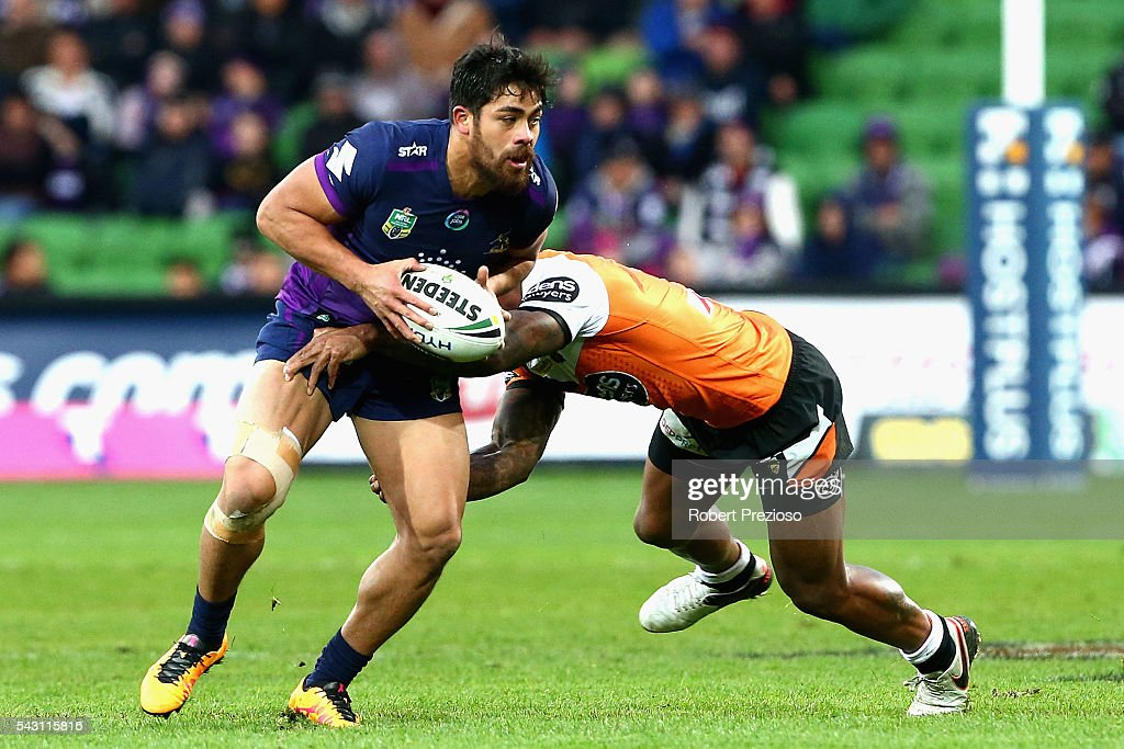 Young Tonumaipea of the Storm is tackled during the round 16 NRL match between the Melbourne Storm and Wests Tigers at AAMI Park on June 26, 2016 in Melbourne, Australia.