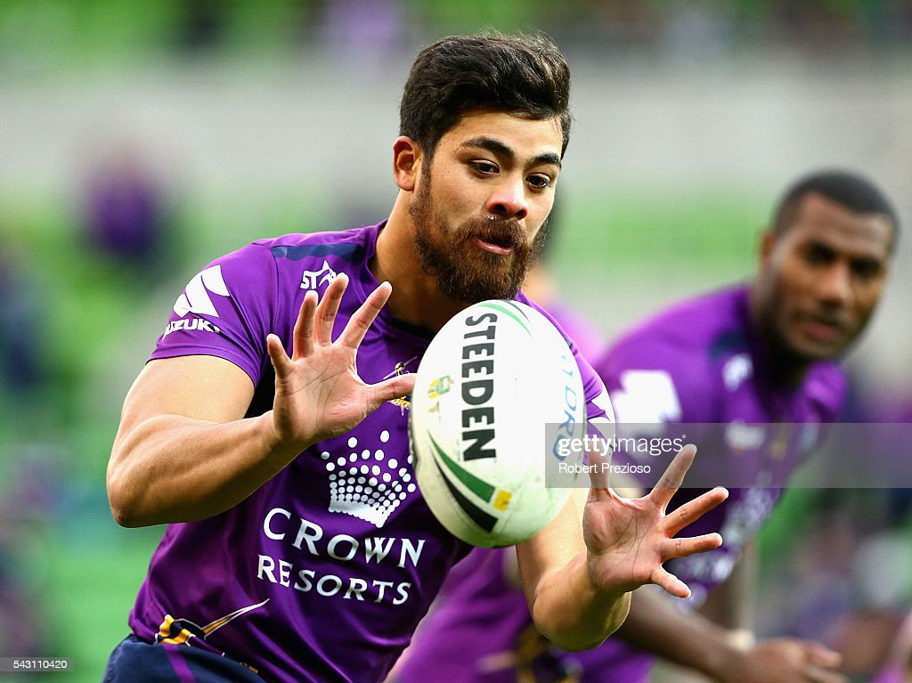 Young Tonumaipea of the Storm receives the ball during warm up prior to the round 16 NRL match between the Melbourne Storm and Wests Tigers at AAMI Park on June 26, 2016 in Melbourne, Australia.