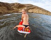 Young woman enjoying waves