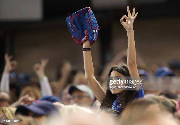 A young Toronto Blue Jays fan makes The Six sign with her hand during the seventh inning stretch during MLB game action against the Baltimore Orioles...