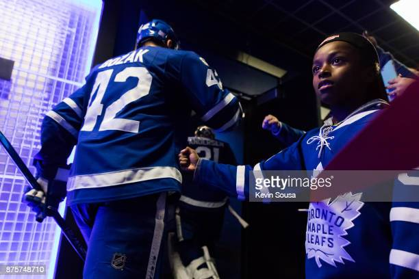 Young Toronto Maple Leafs fan greets Tyler Bozak at an NHL game against the New Jersey Devils at the Air Canada Centre on November 16 2017 in Toronto...