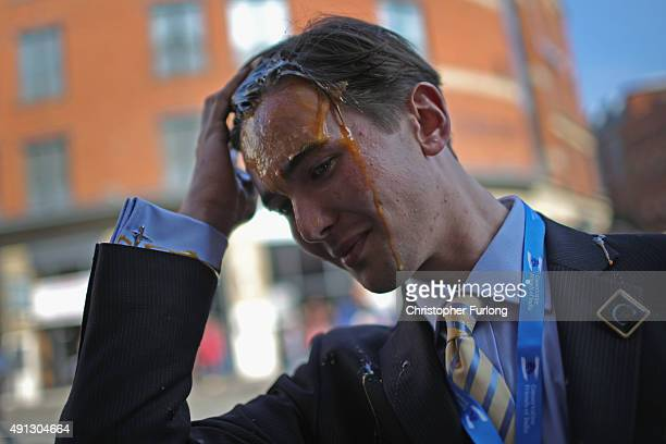 A young Tory delegate is hit by an egg as he arrives for the first day of the Conservative Party Autumn Conference 2015 on October 4 2015 in...