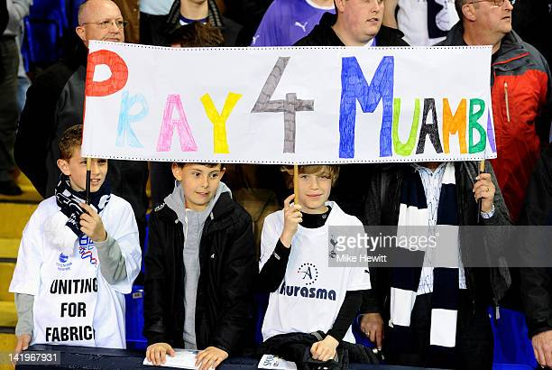 Young Tottenham fans hold up a banner in support of Fabrice Muamba prior to kickoff during the FA Cup sixth round match between Tottenham Hotspur and...
