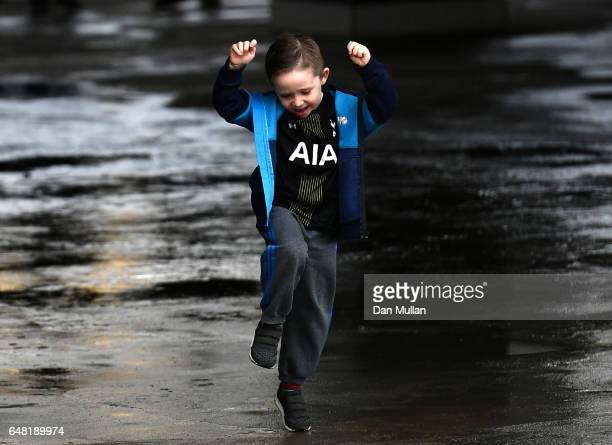 A young Tottenham Hotspur supporter awaits kick off prior to the Premier League match between Tottenham Hotspur and Everton at White Hart Lane on...