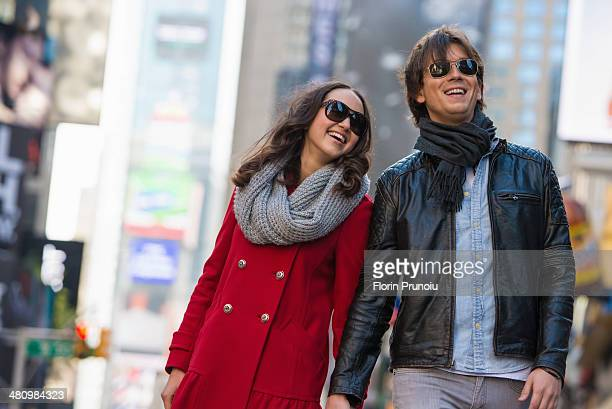 Young tourist couple holding hands, New York City, USA