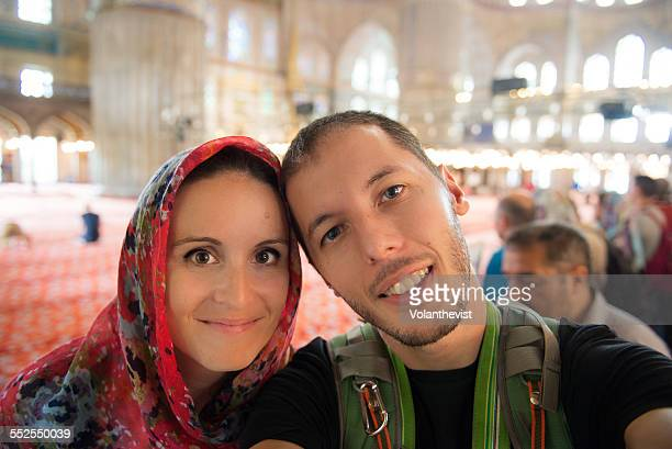 Young tourist couple inside Blue Mosque, Istanbul