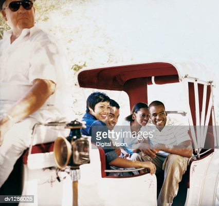 Young Tourist Couples Travelling in a Horse Drawn Carriage in New York, USA