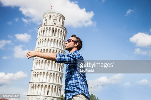 Young tourist having fun in Pisa