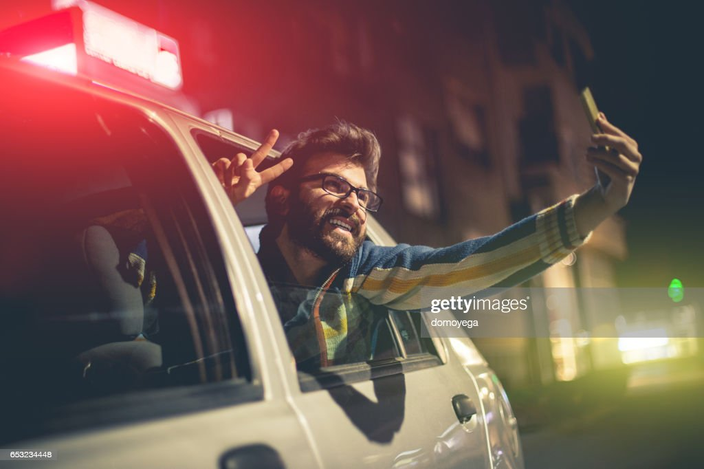 Young tourist taking selfie in the taxi vehicle : Stock Photo