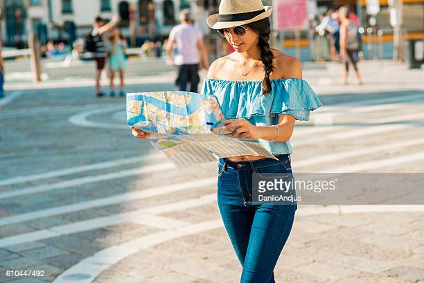 young tourist woman exploring the city