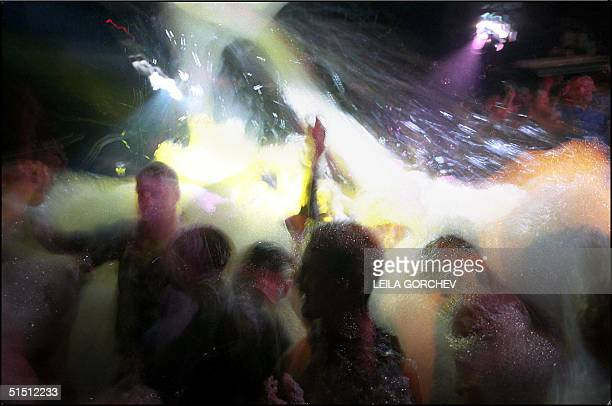 Young tourists dance at a foam party at Plaza Club early 19 June 2001 in the Cyprus popular holiday beach resort of Ayia Napa Ayia Napa is the most...