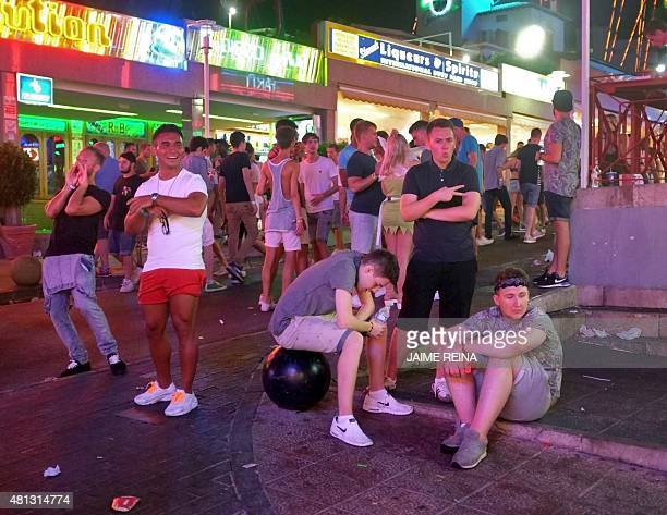 Young tourists gather in Punta Ballena street in Magaluf holiday resort in Calvia on the Spanish Mallorca Island on July 19 2014 Known among some...