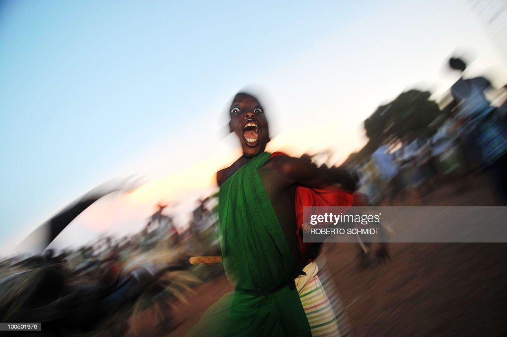 A young traditional drummer performs a dance during a political rally for opposition presidential candidate Agathon Rwasa, in the south western Burundian town of Nyanza-Lac on May 12, 2010. The small African nation of Burundi this week kicks off a tense electoral marathon in which former civil war foes will need to prove they can compete without jeopardising a fragile peace deal. About 3.5 million voters are called to the polling stations on Friday to elect local councillors in what observers argue is a key popularity test for the main contenders in upcoming legislative and presidential polls.