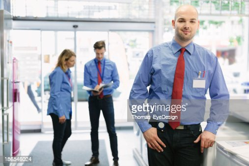 Young trainee in retail store