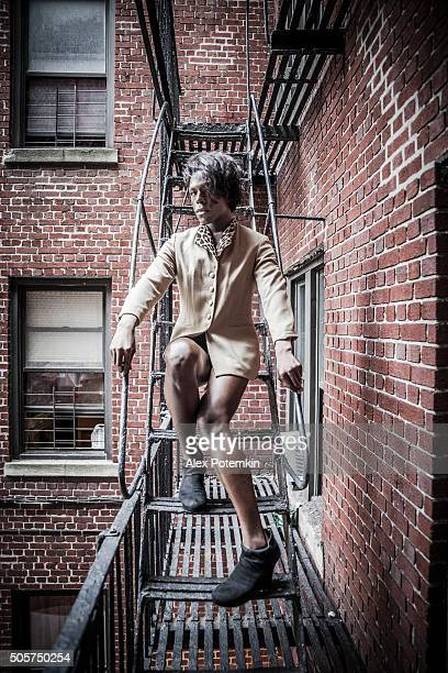 Young transgender woman on the fire stair