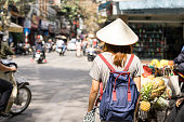 Young traveler with backpack at old quarter in Hanoi, Vietnam