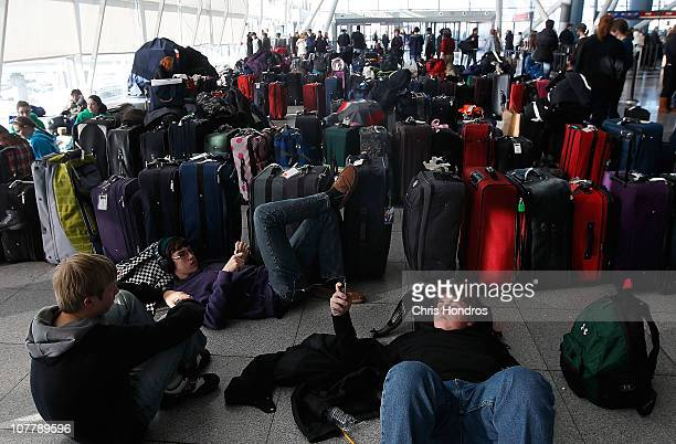 Young travelers rest near dozens of suitcases while stranded at Terminal 4 following a major blizzard at John F Kennedy International Airport...