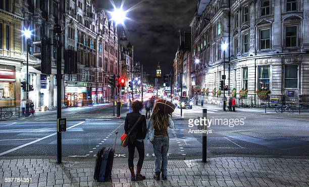 Young travellers in London at night