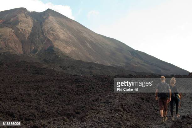 Young travellers walking hiking at Pacaya an active volcano in Guatemala near the old Colonial capital city of Antigua in the Escuintla Department It...
