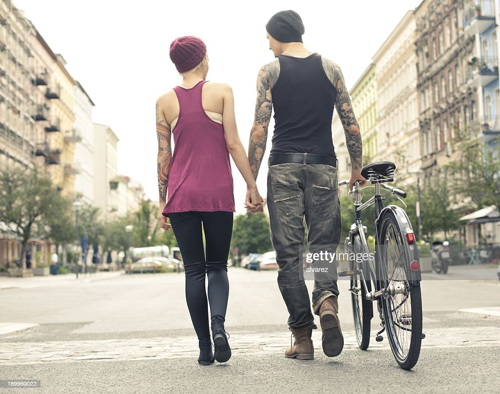 Young trendy couple walking down the streets of Berlin : Stock Photo