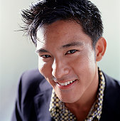Young trendy man posing in studio, portrait