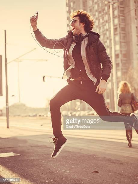 young trendy man taking selfie
