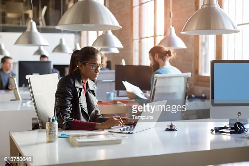 Young trendy people working in a modern creative office