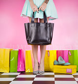 Fashion shopping concept, young trendy woman wearing high heels with shopping bags