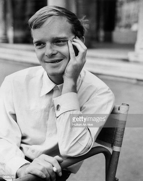 A young Truman Capote sits in a chair leaning against one hand and holding a cigarette in the other Venice Italy