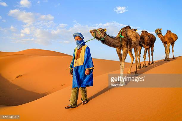Young Tuareg with camels on Western Sahara Desert in Africa