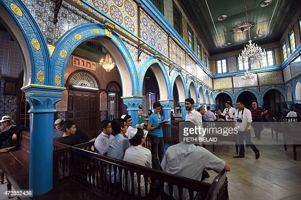 Young Tunisian Jews read the Torah Judaisms most important text at the Ghriba synagogue on the Tunisian resort island of Djerba on May 6 at the start...