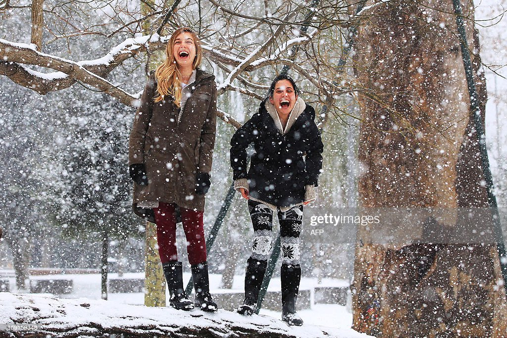 Young Turkish girls enjoy the day during a snow storm in Istanbul on January 9, 2013. Heavy snowfall blanketed Turkey's commercial hub Istanbul, a city of 15 million, paralysing daily life, disrupting air traffic and land transport. AFP PHOTO/MIRA