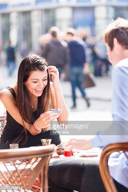 Young Turkish woman fortune telling with coffee