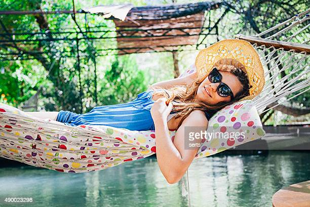 Young Turkish woman resting on hammock