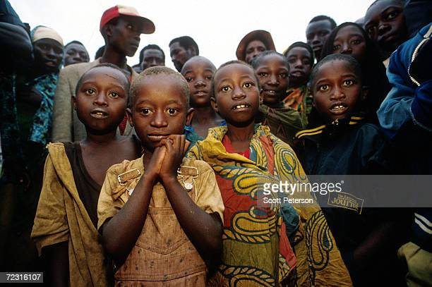 Young Tutsi refugees pray at the Kigali airport in Rwanda April 30 1994 after they survived the Hutuled genocide of Tutsis Nearly one million Tutsis...