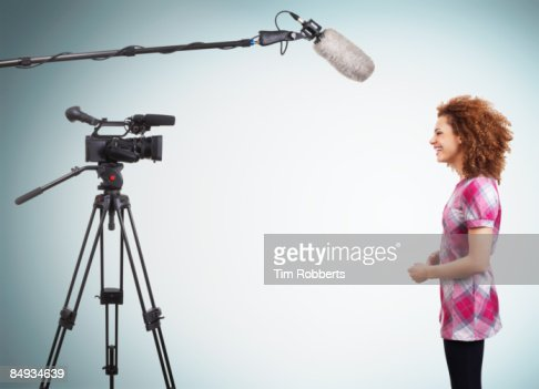 Young TV presenter doing a piece to camera