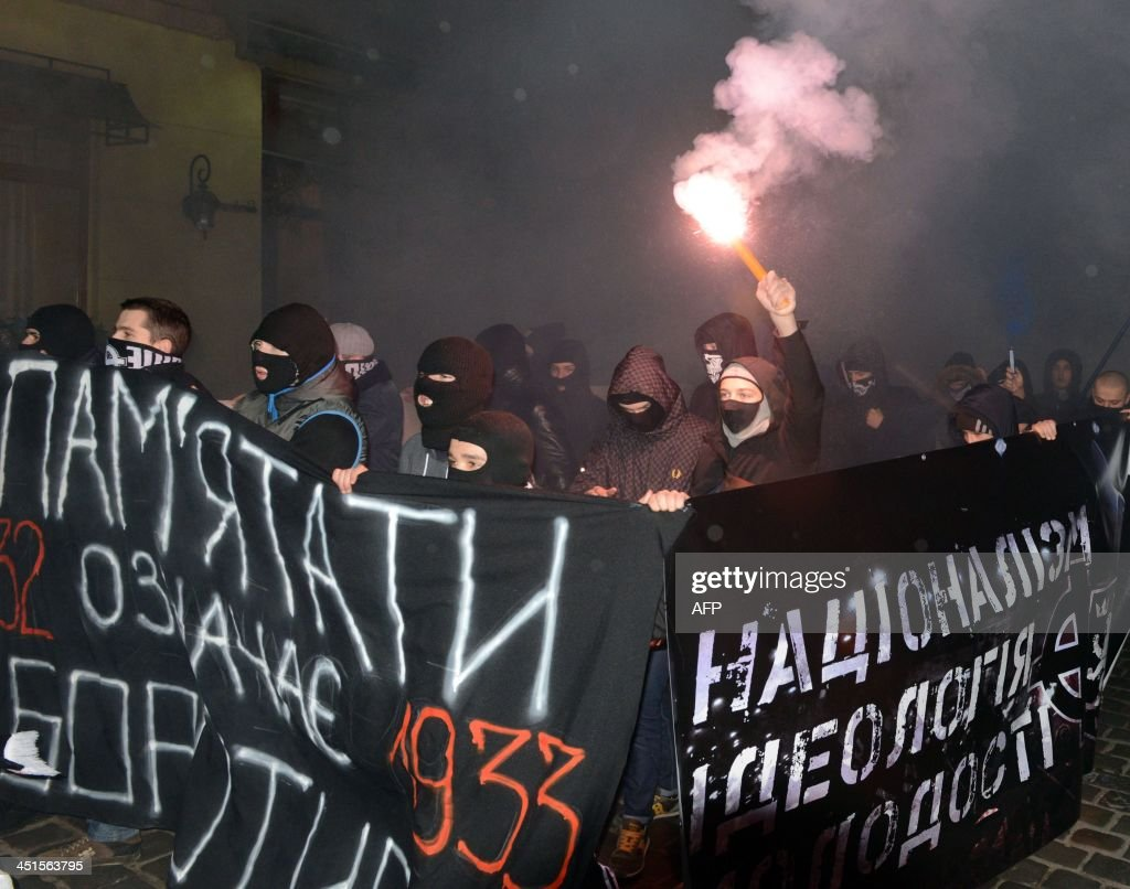 Young ultra-nationalists carry placard reading '1933. Remember - means to fight' during their march in memory of the victims of the Holodomor famine in western Ukrainian city of Lviv on November 29, 2013. Ukraine marked 80 years since the Stalin-era Holodomor famine, one of the darkest pages in its entire history that left millions dead and which is regarded by many as a genocide. The 1932-33 famine took place as harvests dwindled and Josef Stalin's Soviet police enforced the brutal policy of collectivising agriculture by requisitioning grain and other foodstuffs.