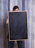 young university man holding a black board
