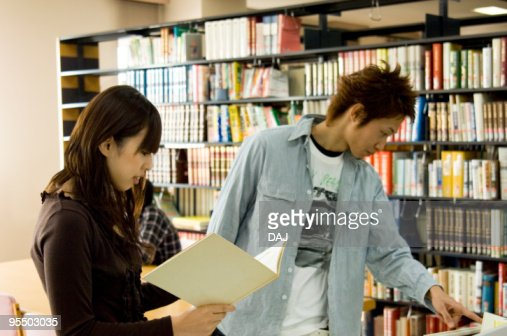 Young university students in library